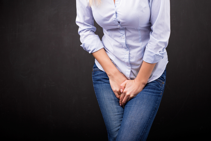 Woman needs to pee because of a yeast infection.