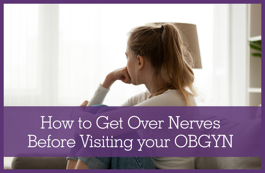 A woman looking off into the distance, wondering how to get rid of your nerves before visiting the obgyn