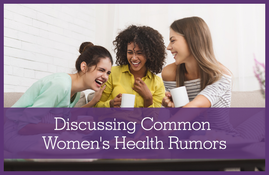 A group of women friends laughing together, discussing common women's health rumors