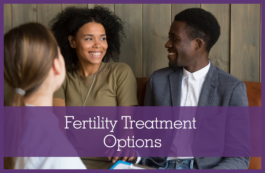 African American couple speaking with a doctor about infertility treatment options.