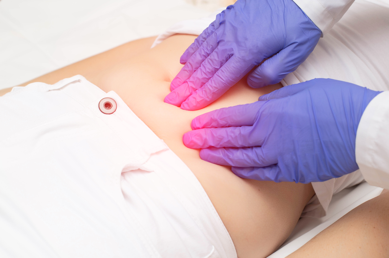 A gynecologist doctor probes the lower abdomen of a girl who has pain and inflammation of the reproductive system. Ovarian cyst, endometriosis, pregnancy pathology, discussing a new uterine fibroid treatment called Acessa.