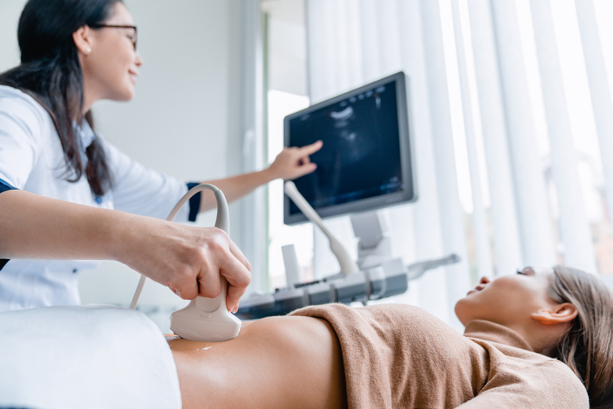 OBGYN Physician giving a patient a Saline-Infused Sonogram.